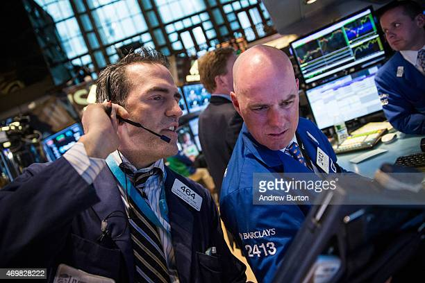 Traders work on the floor of the New York Stock Exchange during the afternoon of April 15 2015 in New York City The Dow Jones Industrial Average...