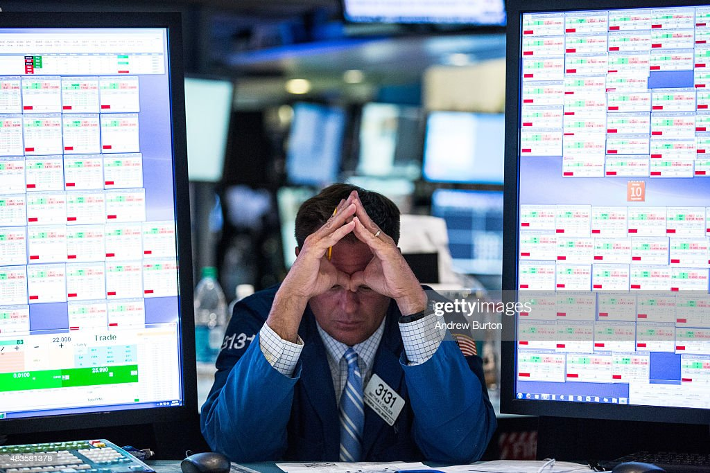 Traders work on the floor of the New York Stock Exchange during the afternoon of August 10 2015 in New York City The Dow Jones surged over 230 points...
