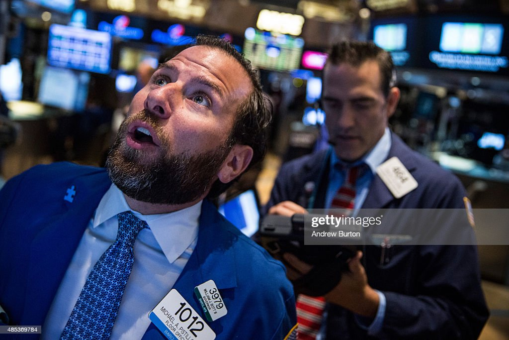 Traders work on the floor of the New York Stock Exchange during the morning of August 27 2015 in New York City Dow Jones Industrial Average stocks...
