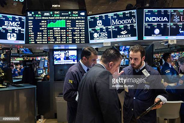 Traders work on the floor of the New York Stock Exchange during the afternoon of December 4 2015 in New York City The market closed more than 370...