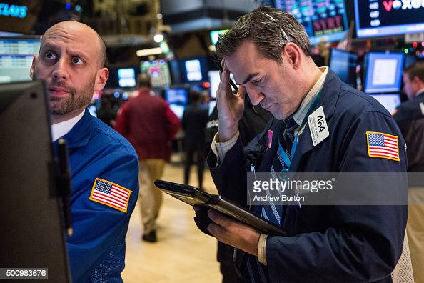 Traders work on the floor of the New York Stock Exchange during the afternoon of December 11 2015 in New York City The Dow Jones Industrial Average...