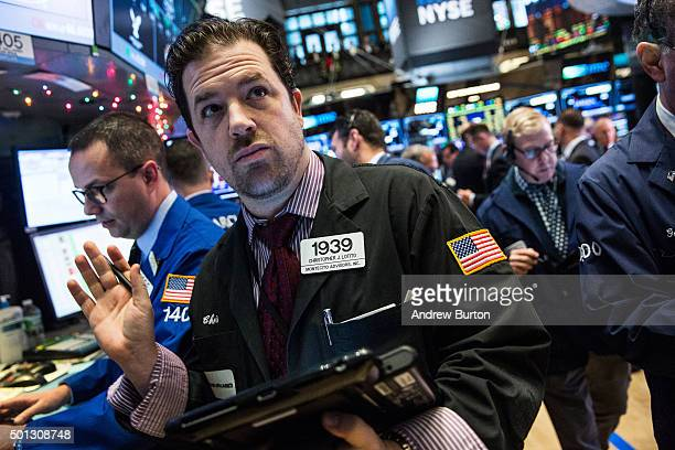Traders work on the floor of the New York Stock Exchange during the morning of December 14 2015 in New York City The Federal Reserve may make an...