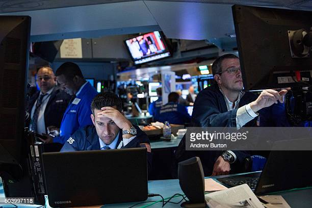 Traders work on the floor of the New York Stock Exchange during the morning of January 8 2016 in New York City US markets have declined over the past...