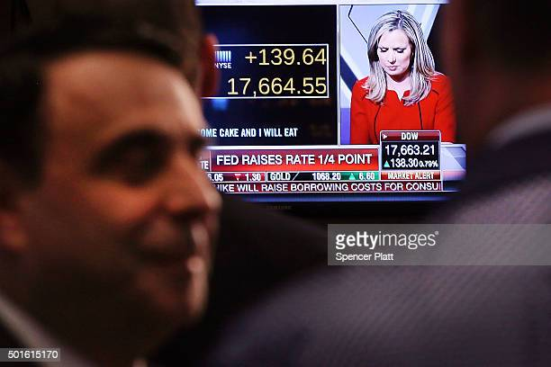 Traders work on the floor of the New York Stock Exchange following an announcement that the Federal Reserve will raise interest rates for the first...