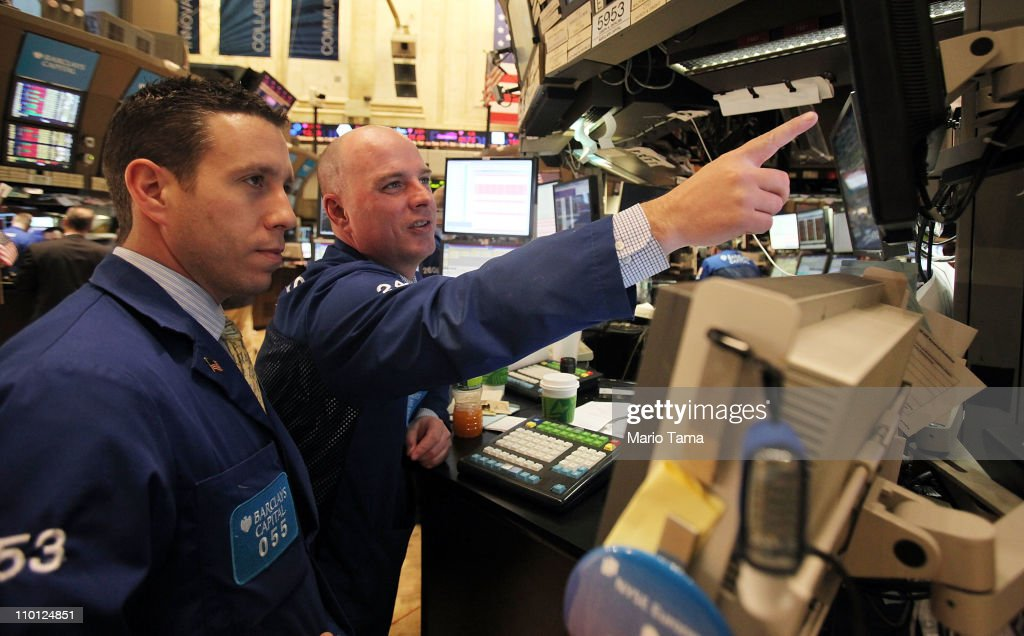 Traders work on the floor of the New York Stock Exchange in afternoon trading on March 15, 2011 in New York City. The Fed left interest rates unchanged at the rate of zero to 0.25 percent. Stocks were down in afternoon trading as markets react to Japan's crisis.