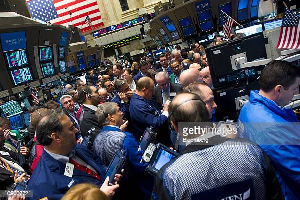 Traders work on the floor of the New York Stock Exchange in New York US on Friday Feb 11 2011 Imax Corp plans to open more than 100 theaters in China...