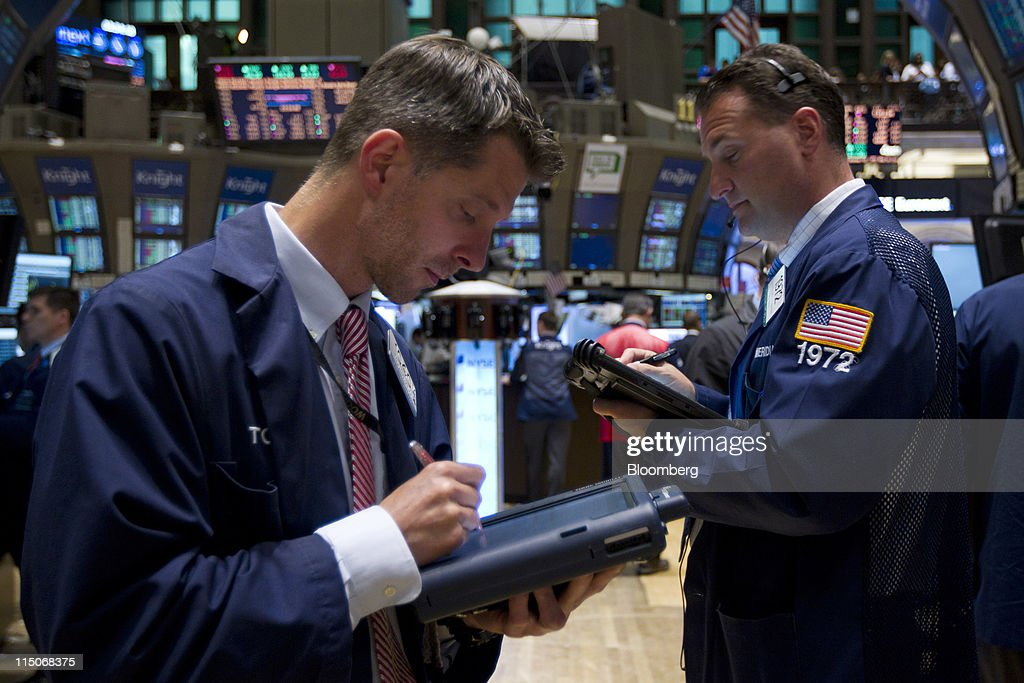 Traders work on the floor of the New York Stock Exchange in New York, U.S., on Thursday, June 2, 2011. U.S. stocks retreated, a day after the biggest slump for the Standard & Poor's 500 Index since August, as investors awaited the Labor Department's monthly report on employment in the world's largest economy. Photographer: Jin Lee/Bloomberg via Getty Images