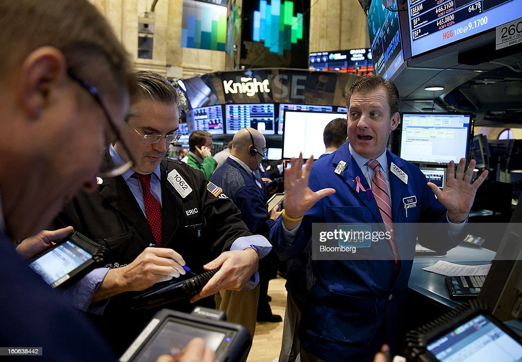 Traders work on the floor of the New York Stock Exchange (NYSE) in New York, U.S., on Monday, Feb. 4, 2013. U.S. stocks fell, after the Standard & Poor's 500 Index jumped to a five-year high, on concern over increasing political tension in Europe as investors awaited data on factory orders. Photographer: Jin Lee/Bloomberg via Getty Images
