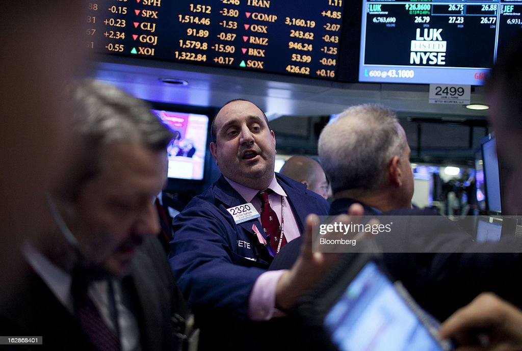 Traders work on the floor of the New York Stock Exchange (NYSE) in New York, U.S., on Thursday, Feb. 28, 2013. U.S. stocks erased gains in the final half hour of trading after the Senate rejected a pair of partisan proposals to replace $85 billion in automatic spending cuts scheduled to start tomorrow. Photographer: Jin Lee/Bloomberg via Getty Images