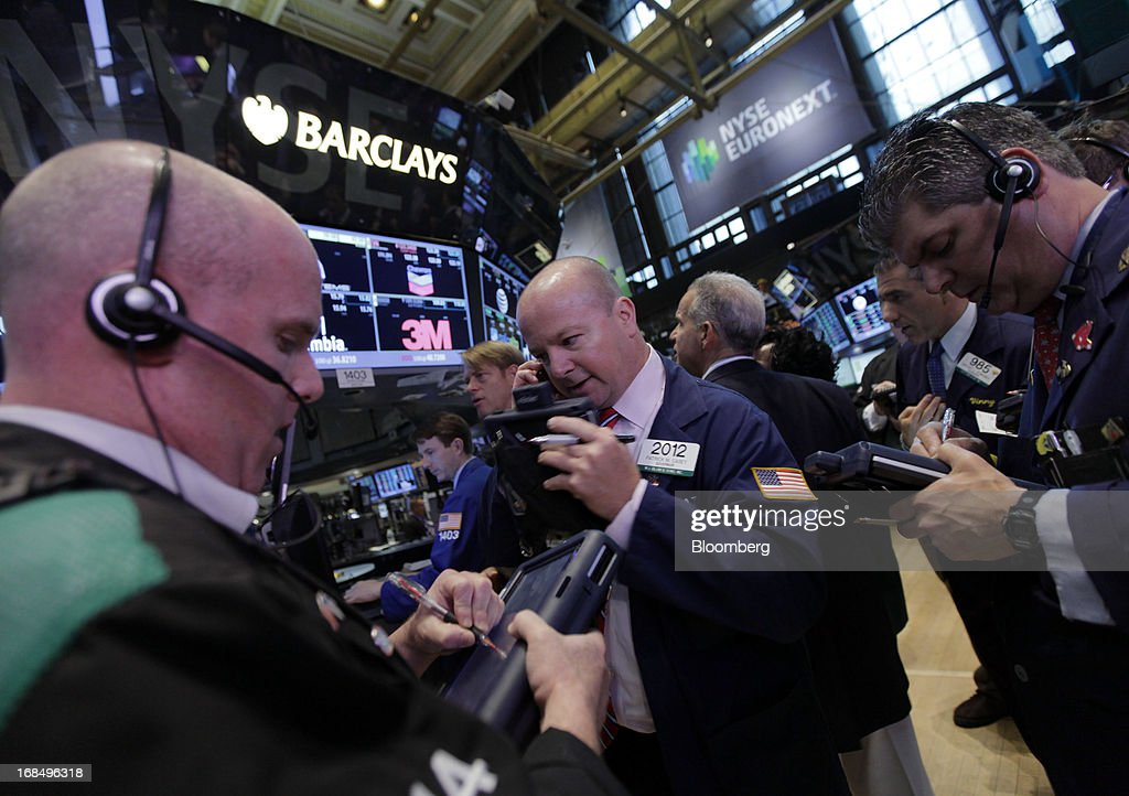 Traders work on the floor of the New York Stock Exchange (NYSE) in New York, U.S., on Friday, May 10, 2013. U.S. stocks rose, with the Standard & Poor's 500 Index poised for a third straight week of gains, as investors weighed the pace of central bank stimulus amid a meeting of finance ministers. Photographer: Jin Lee/Bloomberg via Getty Images