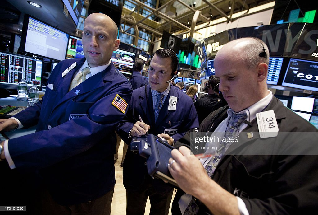 Traders work on the floor of the New York Stock Exchange (NYSE) in New York, U.S., on Thursday, June 13, 2013. U.S. stocks gained, ending a three-day decline in the Standard & Poors 500 Index, amid better-than-forecast economic data and acquisitions in the media and grocery industries. Photographer: Jin Lee/Bloomberg via Getty Images