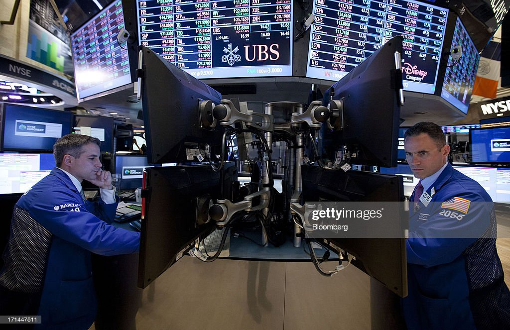 Traders work on the floor of the New York Stock Exchange (NYSE) in New York, U.S., on Monday, June 24, 2013. U.S. stocks fell after Chinese equities entered a bear market on concern a cash crunch will hurt growth. Treasuries pared losses on speculation investors overreacted to a possible reduction of central bank stimulus. Photographer: Jin Lee/Bloomberg via Getty Images