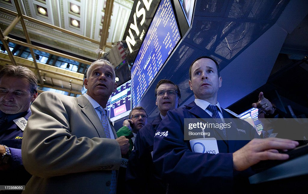 Traders work on the floor of the New York Stock Exchange (NYSE) in New York, U.S., on Tuesday, July 2, 2013. U.S. stocks rose, following the Standard & Poors 500 Indexs gain yesterday, as U.S. factory orders rose in May and investors awaited comments from Federal Reserve officials. Photographer: Jin Lee/Bloomberg via Getty Images