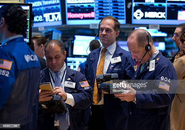Traders work on the floor of the New York Stock Exchange in New York US on Friday Dec 27 2013 US stocks rose sending the Standard Poors 500 Index to...
