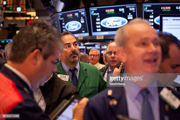 Traders work on the floor of the New York Stock Exchange in New York US on Friday Jan 8 2016 The Standard Poor's 500 Index fluctuated near a...