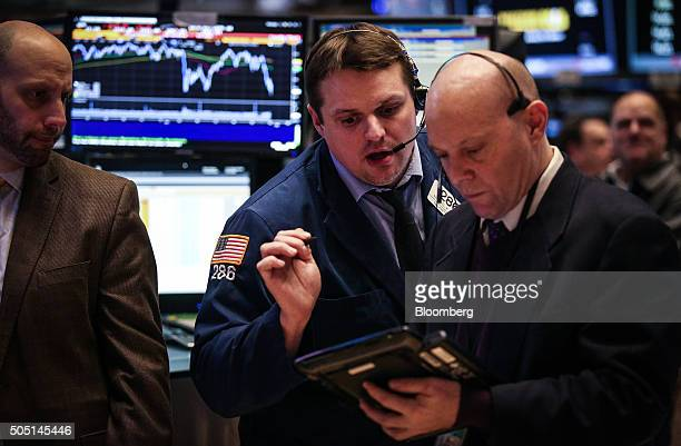 Traders work on the floor of the New York Stock Exchange in New York US on Friday Jan 15 2016 Stocks tumbled around the world with US equities headed...