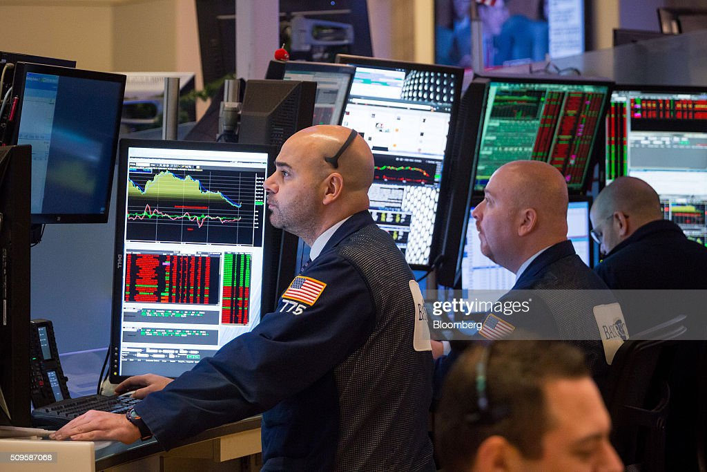 Traders work on the floor of the New York Stock Exchange (NYSE) in New York, U.S., on Thursday, Feb. 11, 2016. Global equities tumbled toward a bear market, with the Dow Jones Industrial Average plunging to 400 points, as financial markets signaled that investors have lost faith in central banks' ability to support the worldwide economy. Photographer: Michael Nagle/Bloomberg via Getty Images