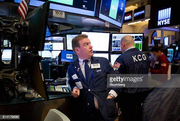 Traders work on the floor of the New York Stock Exchange in New York US on Monday March 7 2016 US stocks fluctuated near twomonth highs as commodity...