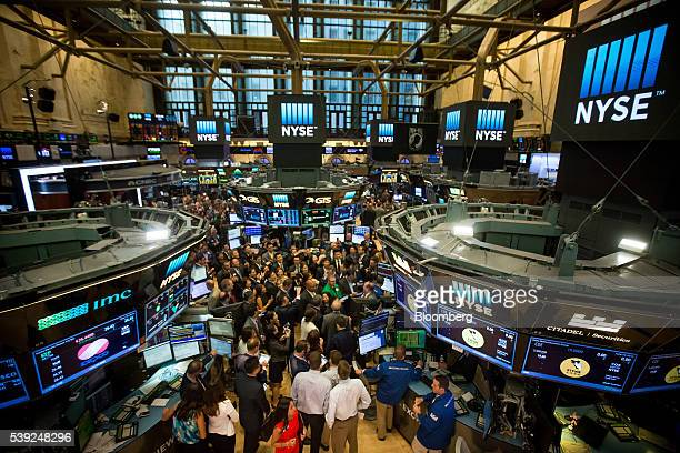 Traders work on the floor of the New York Stock Exchange in New York US on Friday June 10 2016 US stocks retreated with the SP 500 Index headed for...