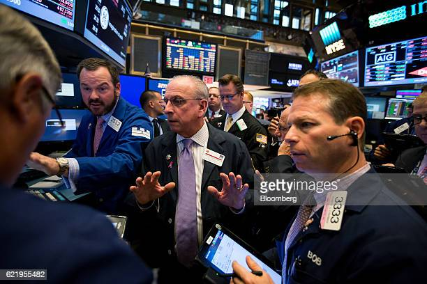 Traders work on the floor of the New York Stock Exchange in New York US on Wednesday Nov 9 2016 US stocks fluctuated in volatile trading in the...