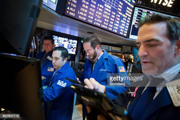 Traders work on the floor of the New York Stock Exchange in New York US on Monday March 13 2017 US stocks held steady as they kicked off a week...