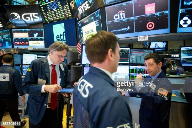 Traders work on the floor of the New York Stock Exchange in New York US on Tuesday April 11 2017 US stocks slid as investors assessed geopolitical...
