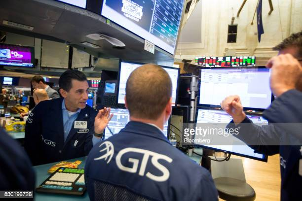 Traders work on the floor of the New York Stock Exchange in New York US on Friday Aug 11 2017 US stocks halted a threeday slide volatility eased and...