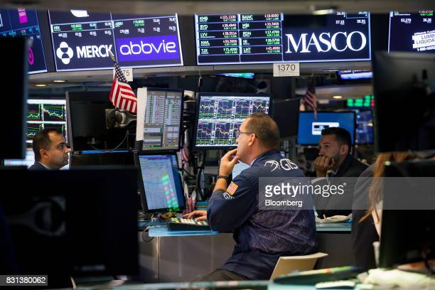 Traders work on the floor of the New York Stock Exchange in New York US on Monday Aug 14 2017 US stockindex futures advanced and volatility subsided...