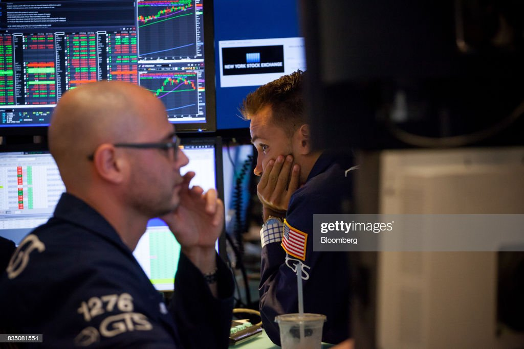 Traders work on the floor of the New York Stock Exchange (NYSE) in New York, U.S., on Friday, Aug. 18, 2017. Stocks were mixed and the S&P 500 Index turned higher as investors digested the political upheaval in the U.S. and the latest terrorist attack in Europe. Photographer: Michael Nagle/Bloomberg via Getty Images