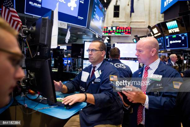 Traders work on the floor of the New York Stock Exchange in New York US on Friday Sept 8 2017 The dollar fell to the weakest in more than two years...