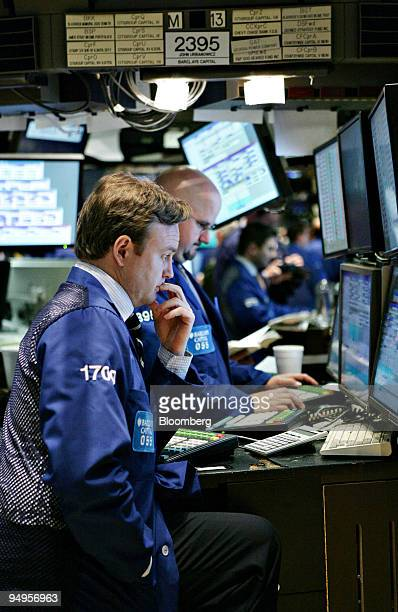 Traders work on the floor of the New York Stock Exchange in New York US on Monday April 6 2009 US stocks fell for the first time in five days as Mike...