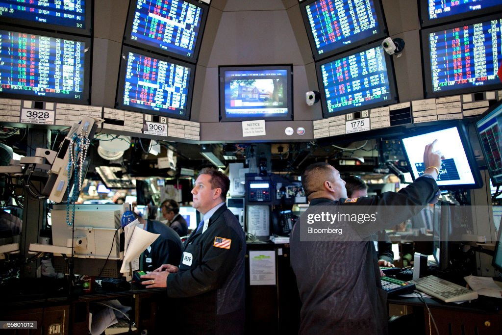 Traders work on the floor of the New York Stock Exchange in New York US on Friday Jan 15 2010 US stocks and commodities slid while the dollar and...