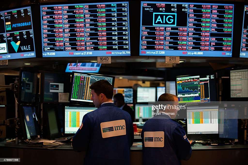 Traders work on the floor of the New York Stock Exchange in the afternoon on June 29 2015 in New York City The Dow plunged 300 points as the Greek...
