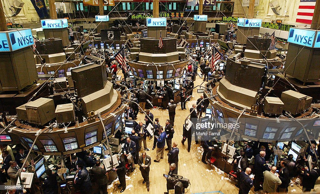Traders work on the floor of the New York Stock Exchange January 9 2006 in New York City The Dow Jones industrial average passed the 11000 mark today...