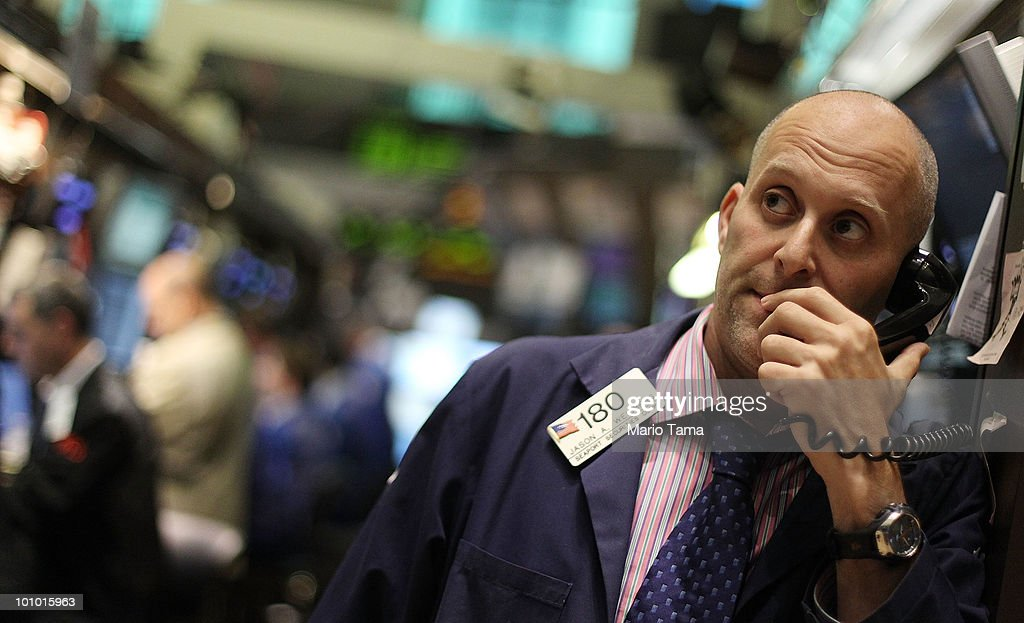 Traders work on the floor of the New York Stock Exchange May 27, 2010 in New York City. The Dow finished up 284 points to close at 10258.99 led by energy, technology and financial stocks.