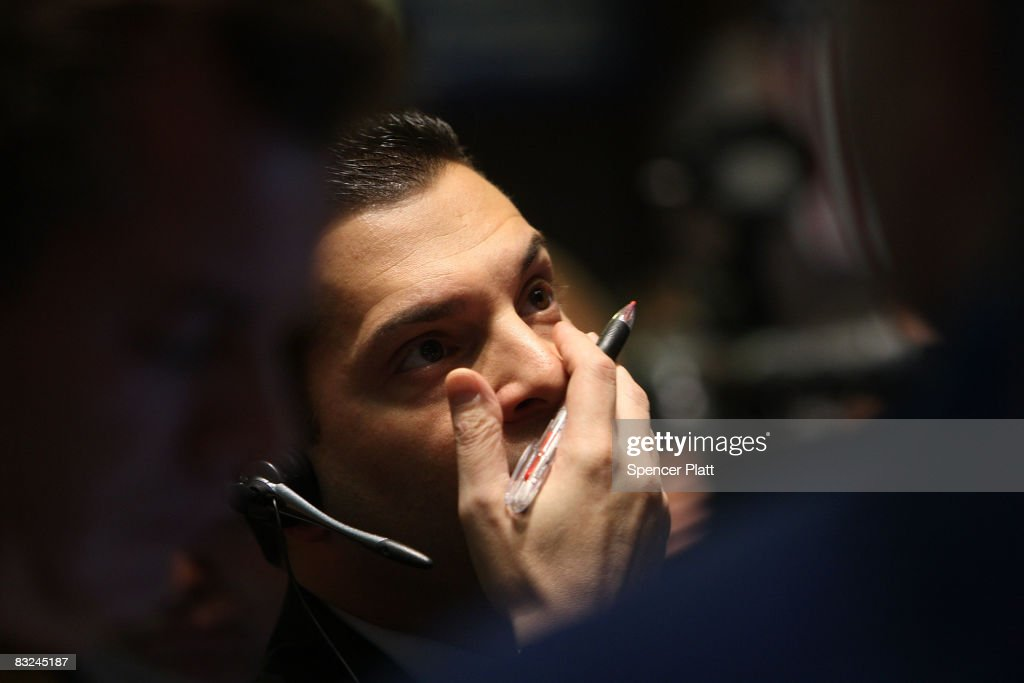 Traders work on the floor of the New York Stock Exchange moments after the opening bell October 13 2008 in New York City Following a rise in global...