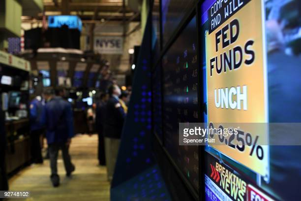 Traders work on the floor of the New York Stock Exchange moments before the Federal Reserve announced it would leave interest rates unchanged on...