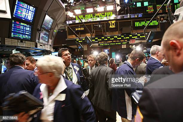Traders work on the floor of the New York Stock exchange October 10 2008 in New York City Markets were volatile in morning trading with the Dow...