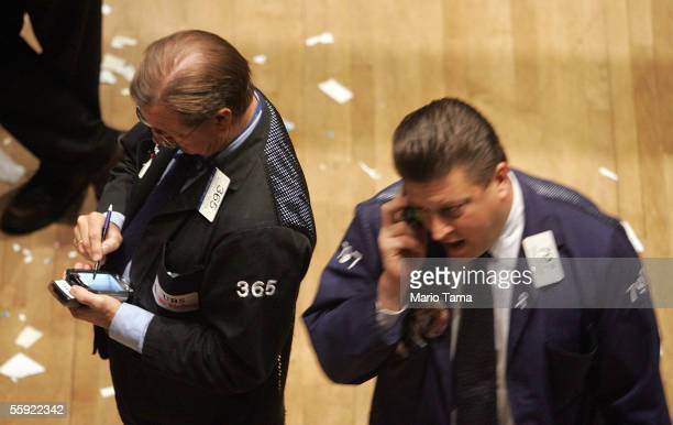 Traders work on the floor of the New York Stock Exchange October 14 2005 in New York City Stocks rose after the government reported relatively mild...