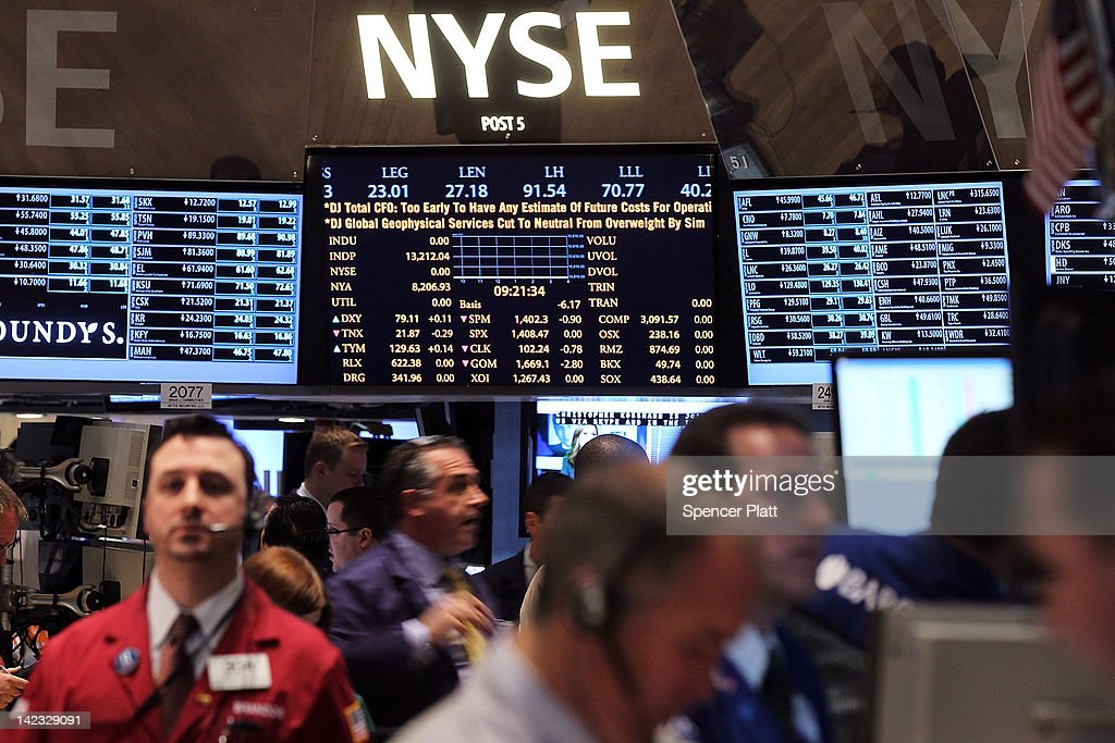 Traders work on the floor of the New York Stock Exchange on April 2, 2012 in New York City. In the first trading day of April, U.S. stocks opened the second quarter with limited gains with the Dow Jones Industrial Average added 37.95 points to 13,249 in morning trading.