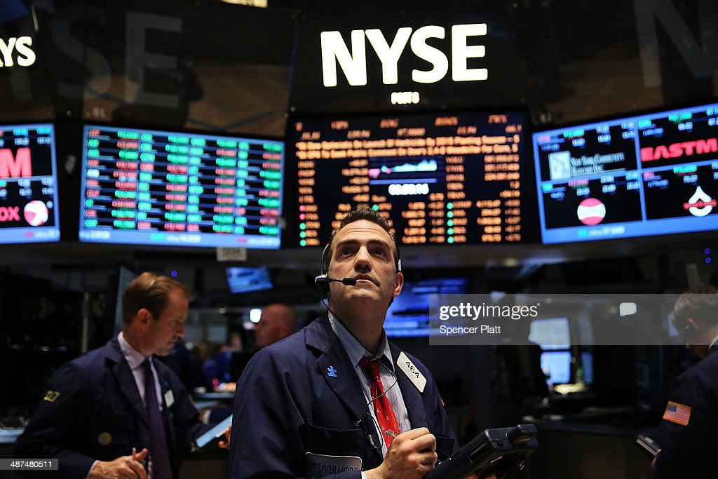 Traders work on the floor of the New York Stock Exchange on April 30 2014 in New York City The Dow Jones industrial average closed at a new record...