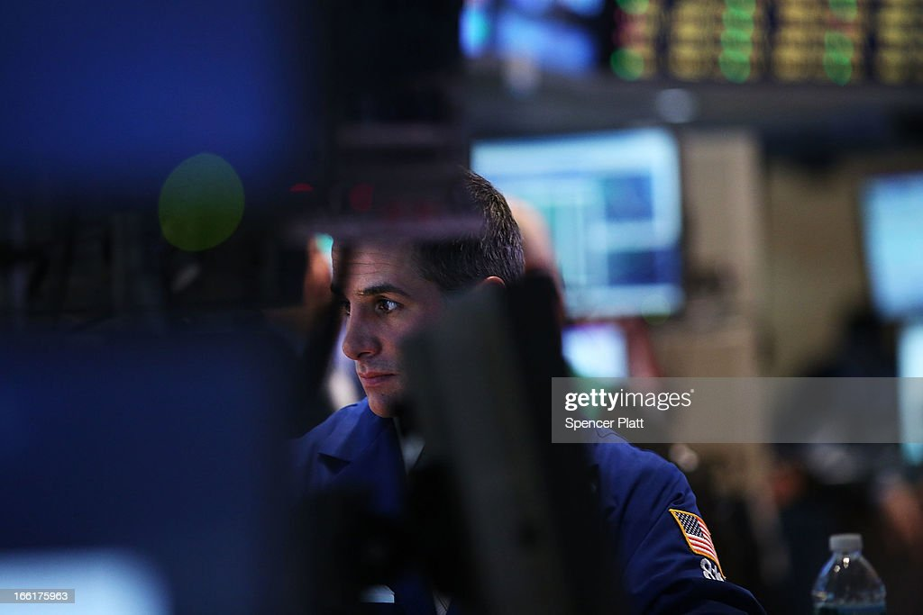 Traders work on the floor of the New York Stock Exchange on April 9, 2013 in New York City. The Dow Jones Industrial Average hit a new record trading high of 14,706 today, while closing slightly lower at 14,673.46.
