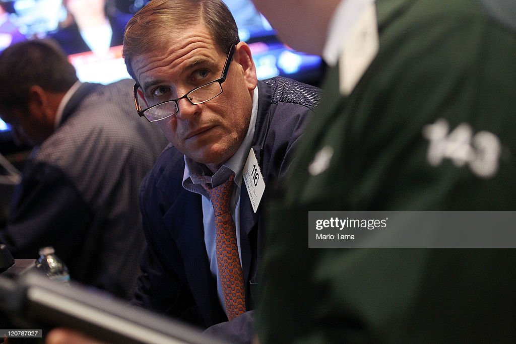 Traders work on the floor of the New York Stock Exchange on August 10, 2011 in New York City. The Dow plummeted more than 500 points at the end of the day as global economic turmoil continues.