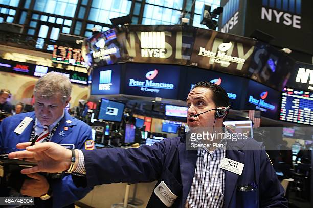 Traders work on the floor of the New York Stock Exchange on August 21 2015 in New York City The Dow fell over 150 points in morning trading as global...
