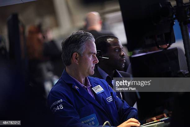 Traders work on the floor of the New York Stock Exchange on August 21 2015 in New York City The Dow fell over 500 points in trading today as global...