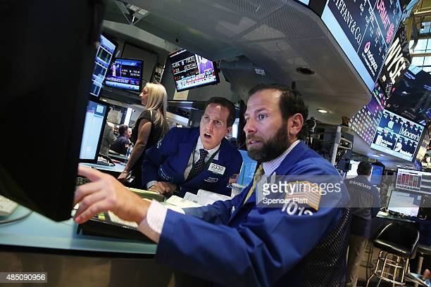 Traders work on the floor of the New York Stock Exchange on August 24 2015 in New York City As the global economy continues to react from events in...