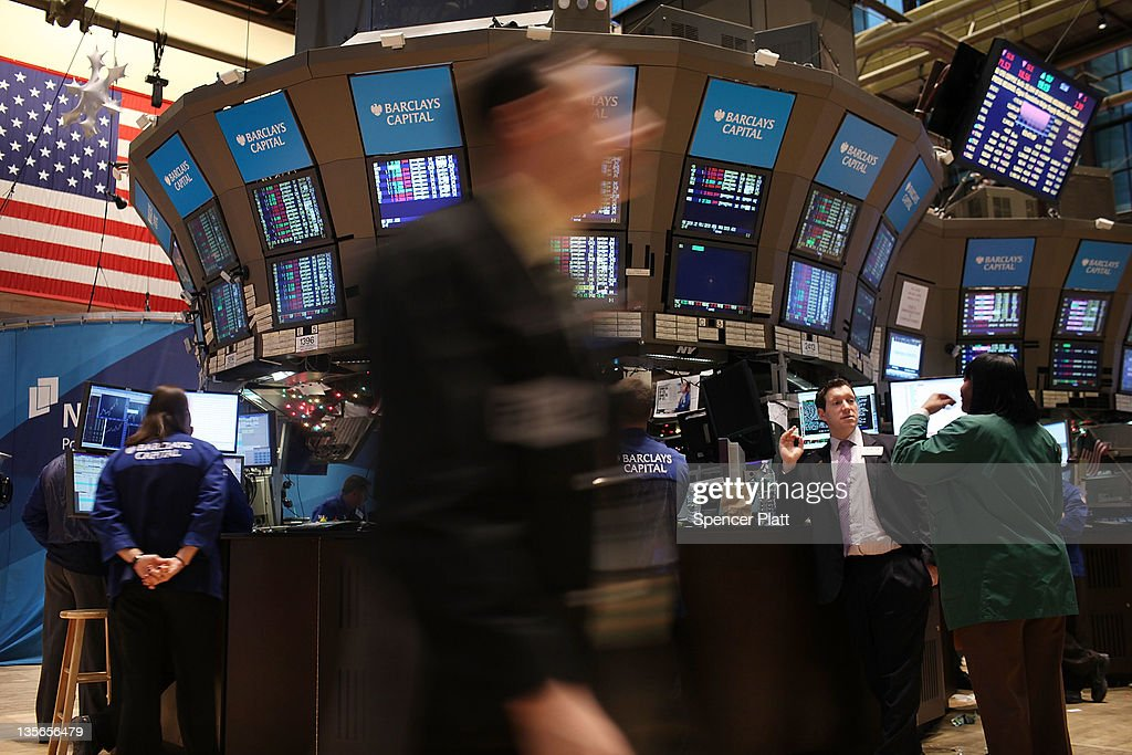 Traders work on the floor of the New York Stock Exchange on December 12, 2011 in New York City. Following fresh investor doubts about Europe's debt crisis, the Dow Jones industrial average slid 162 points, or 1.3%.