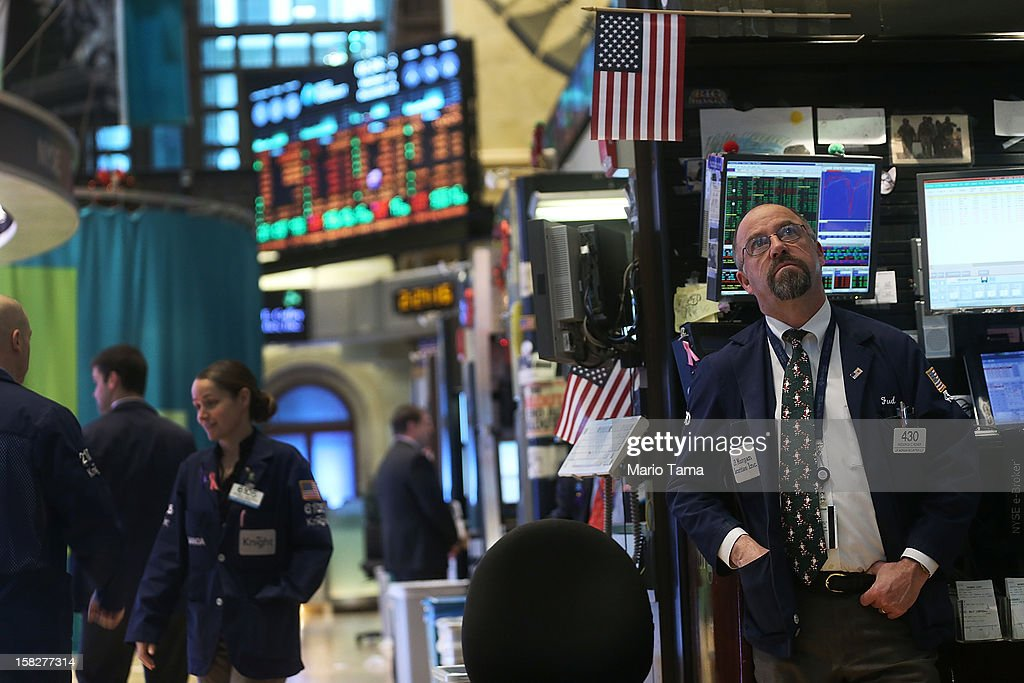 Traders work on the floor of the New York Stock Exchange on December 12, 2012 in New York City. Federal Reserve Chairman Ben Bernanke announced the Federal Reserve will tie its bond purchase program to the rate of the nation's unemployment.