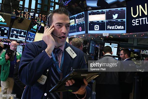 Traders work on the floor of the New York Stock Exchange on December 21 2015 in New York City The Dow Jones industrial average was up over 100 points...