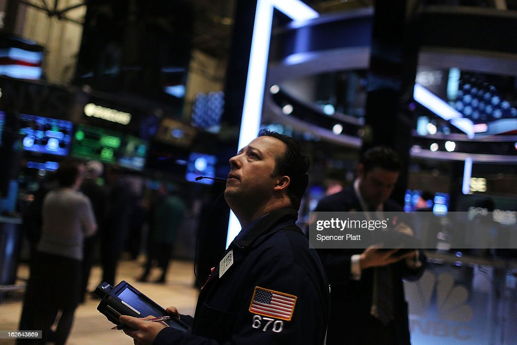 Traders work on the floor of the New York Stock Exchange on February 25, 2013 in New York City. The Dow Jones industrial average and the S&P 500 both gained about 0.5% in morning trading following positive news in overseas markets.